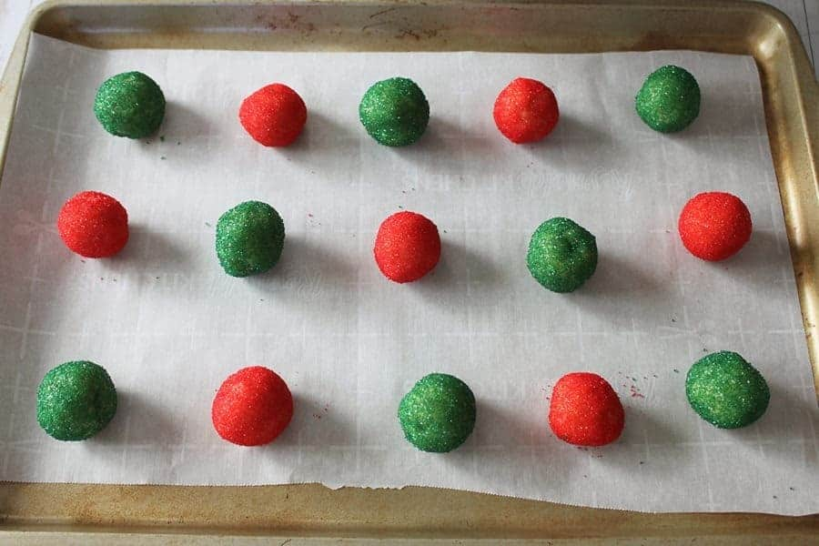 Unbaked cookies rolled in green and red sugar