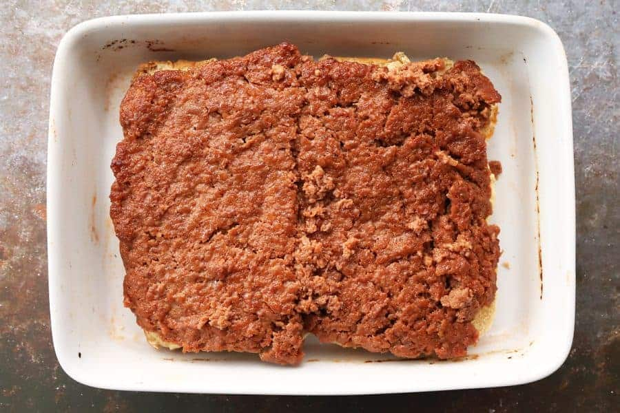 Ground Pork is now sitting on top of the bottom half of the buns