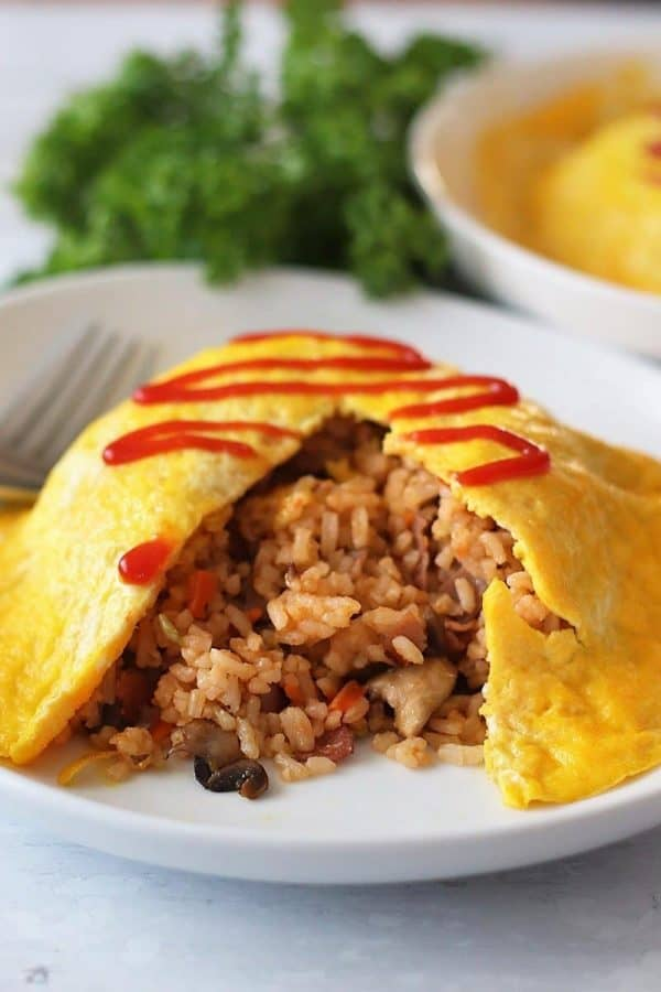 Inside view of the fried rice under the omelet