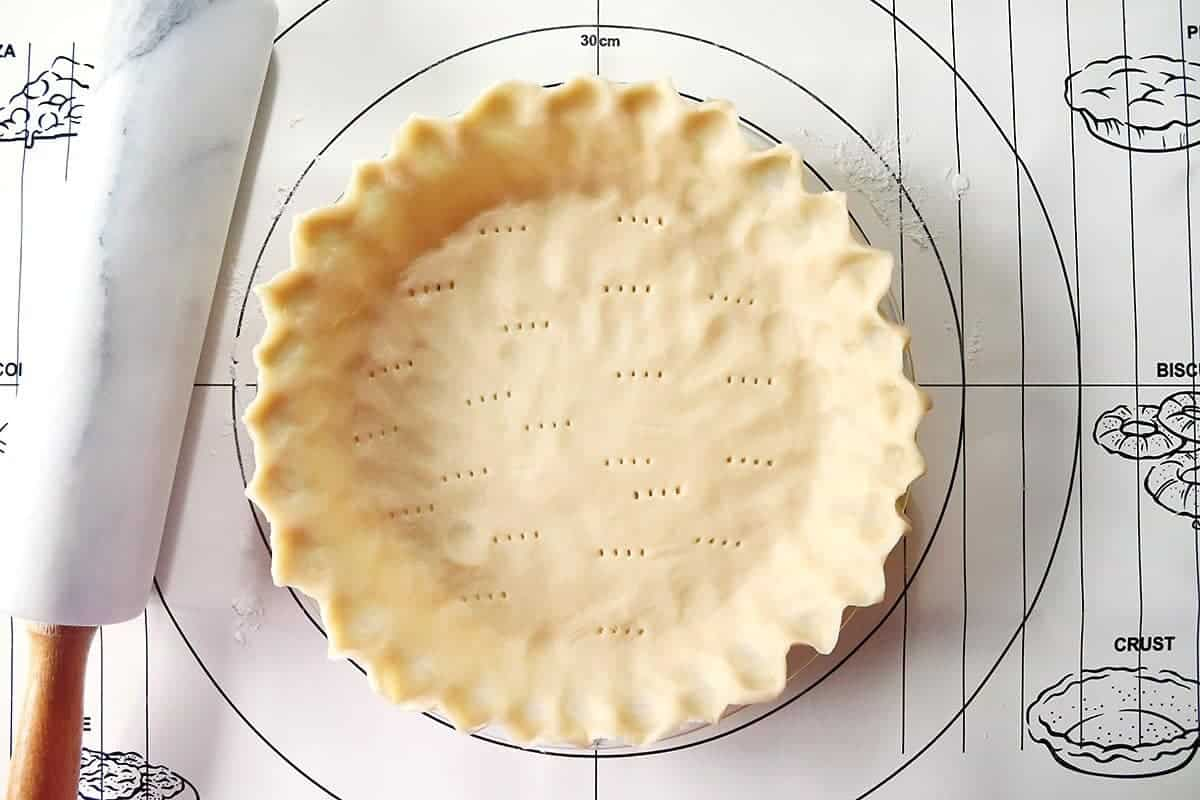 Pie Dough in Pan Poked with Fork