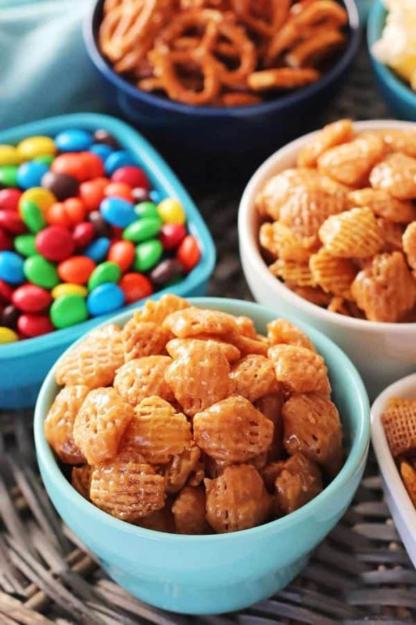 Caramel Crispix with other movie night treats like M&M's, pretzels, popcorn, and Chex mix.