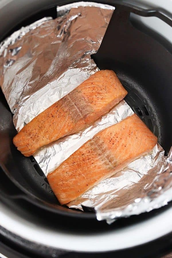 Salmon fillets sitting in the air fryer