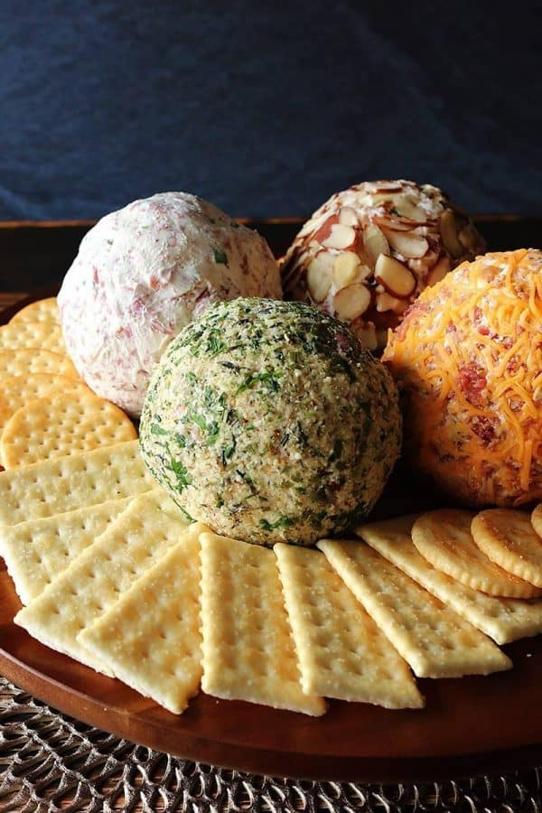 Four party cheese balls with crackers
