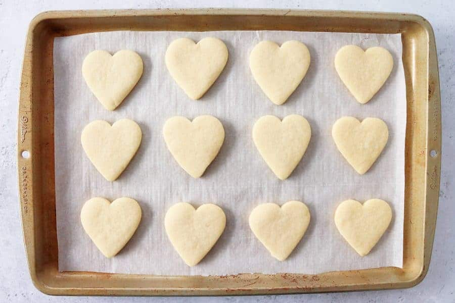 Baked heart-shaped cookies on a baking sheet