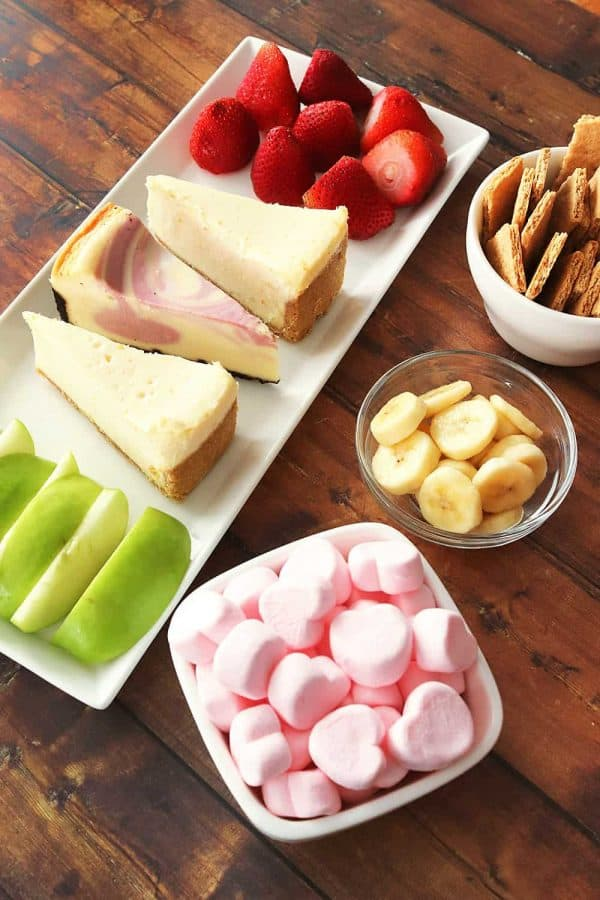 Things to dip in chocolate fondue - strawberries, cheesecake, graham crackers, banana slices, marshmallows, and green apple slices
