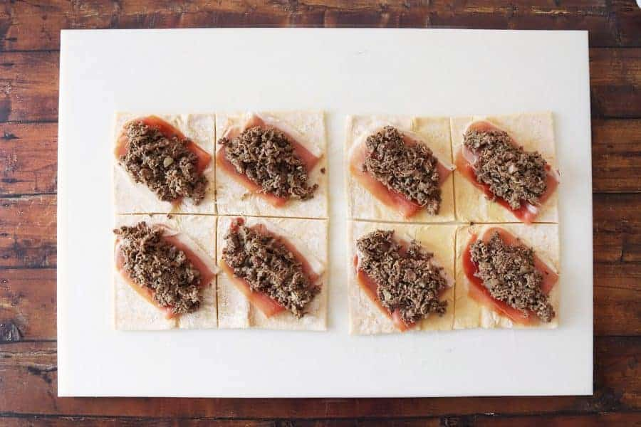 Puff pastry topped with prosciutto and sirloin mixture