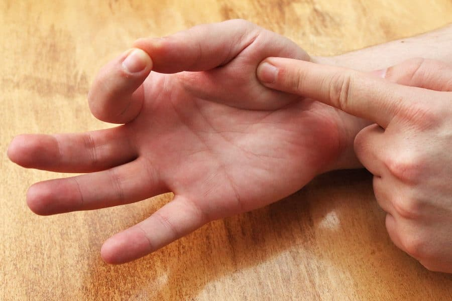 Pressing palm with index finger while touching index finger
