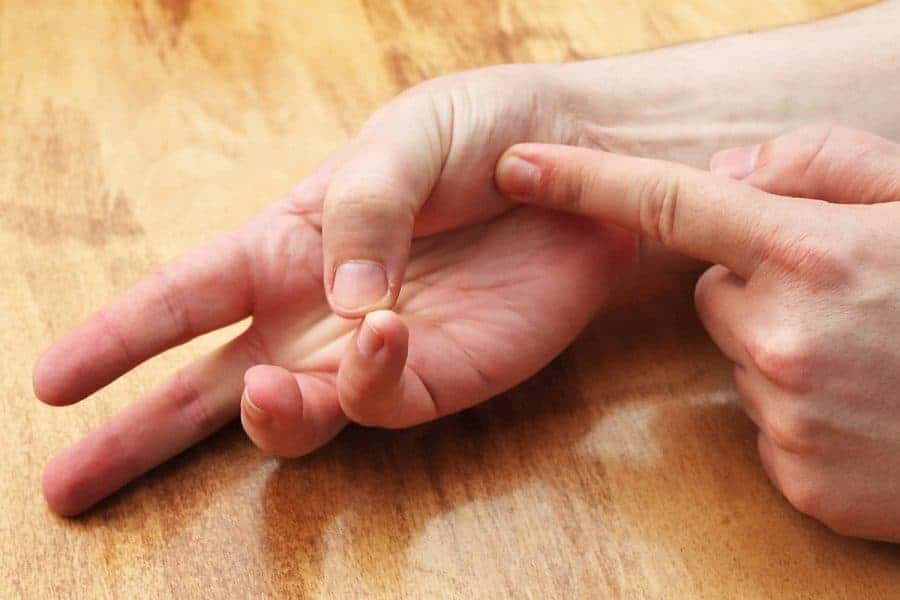 Pressing palm with index finger while touching pinky finger