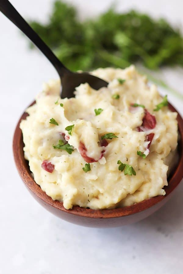 Garlic Mashed Potatoes in a bowl with a spoon